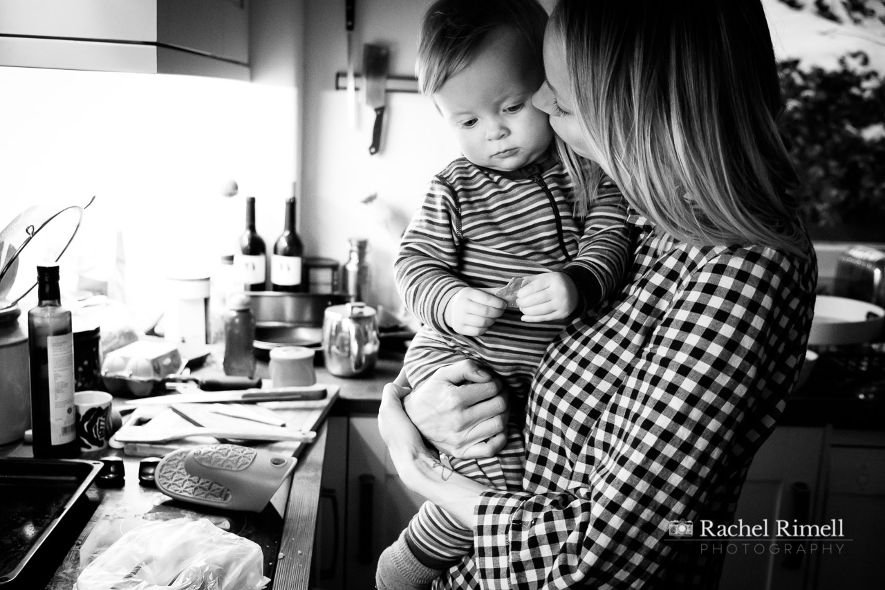 mother cuddles toddler documentary photo