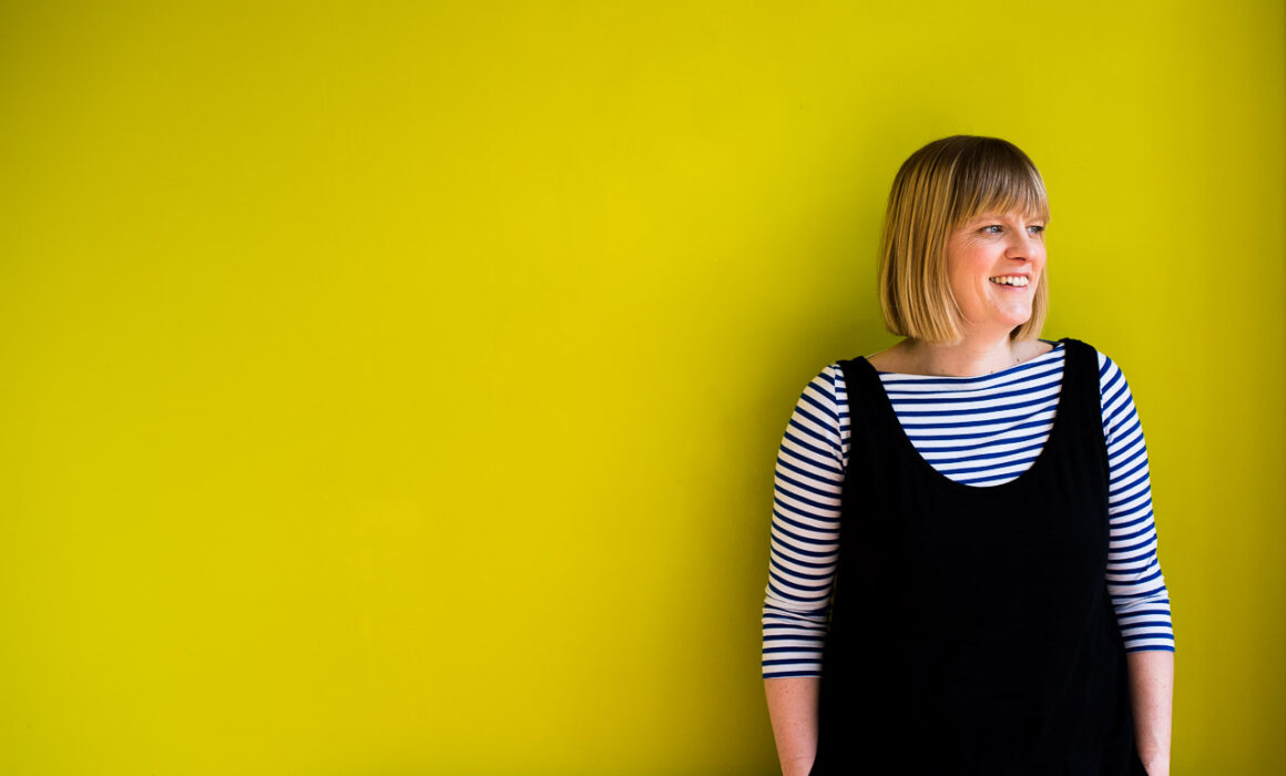 Colourful professional headshot of Janine Green Coach against lime green background, Crystal Palace, London