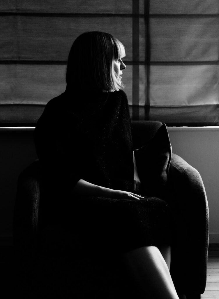 Alternative personal branding portrait and headshot of life coach Janine Green, black and white moody portrait, London
