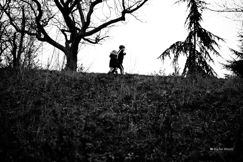 natural family photography brother and sister in black and white in woodland, London