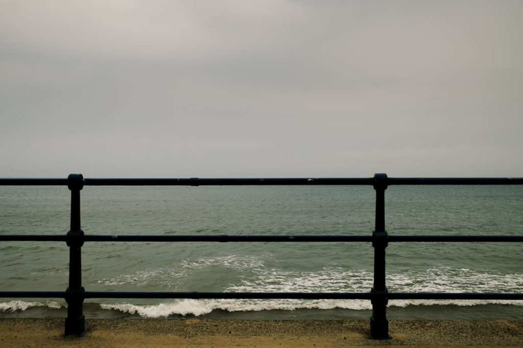 railings on the sea front at Filey in the rain