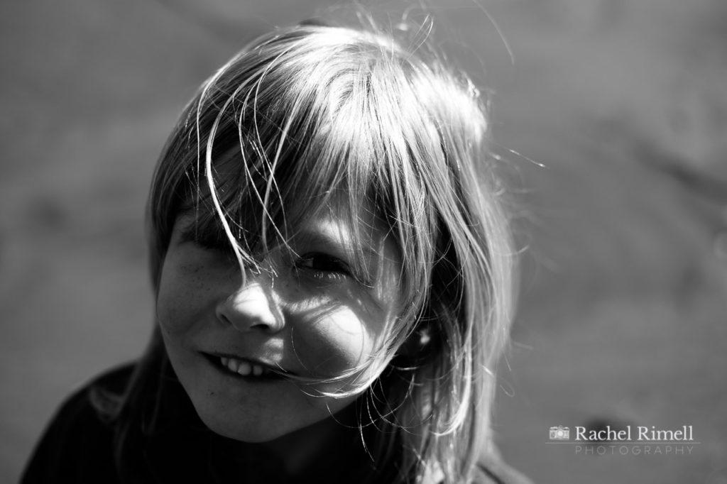 Natural black and white portrait of a child on Whitby beach