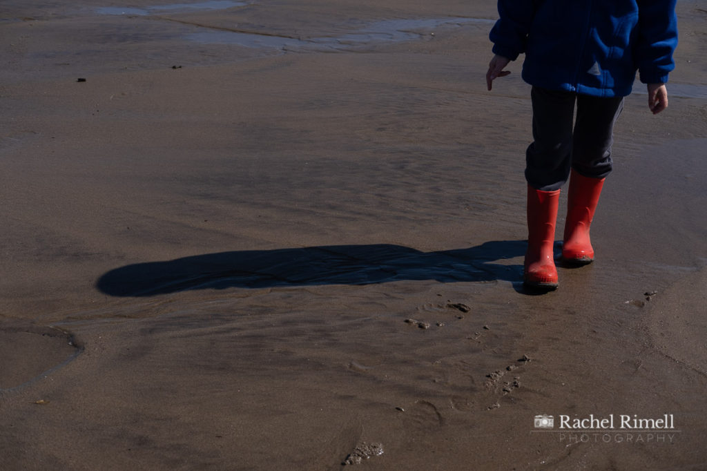 red wellington boots on Whitby beach